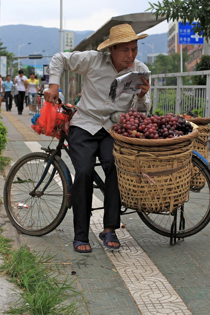 Chinese man with grapes
