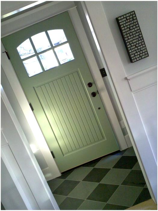 House remodel entry way green door
