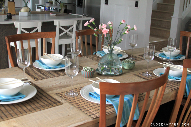 Dining room table setting white kitchen